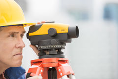 Cartographer Measuring Distances Through Theodolite Royalty Free Stock Image