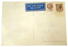 Cartolina in bianco con i francobolli Fotografia Stock
