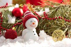 Cartolina con il pupazzo di neve ed il natale Fotografie Stock Libere da Diritti