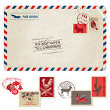 Cartolina d'annata di Natale con i francobolli Immagine Stock Libera da Diritti