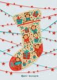 Cartolina d'auguri con il calzino di Natale Vettore Fotografia Stock Libera da Diritti