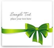 Cartolina d'auguri con un nastro verde Immagine Stock