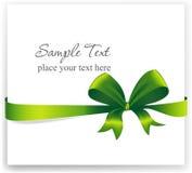 Cartolina d'auguri con un nastro verde Immagini Stock