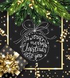 Cartolina d'auguri del buon anno e di Buon Natale con con i rami di Natale, con il regalo di Natale, con le decorazioni sopra Immagine Stock