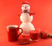 Cartolina d'auguri del nuovo anno con il pupazzo di neve tricottato Fotografia Stock