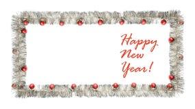 Cartolina d'auguri del nuovo anno fatta del telaio d'argento del lamé con le palle rosse di natale Immagini Stock