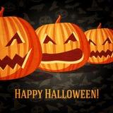 Cartolina d'auguri di Halloween con le zucche scolpite Fotografie Stock
