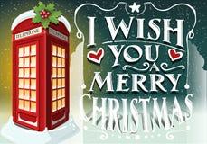 Cartolina d'auguri di Natale con la cabina rossa inglese Fotografie Stock Libere da Diritti