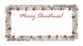 Cartolina d'auguri di Natale fatta del telaio d'argento del lamé con le palle rosse di natale Immagine Stock Libera da Diritti