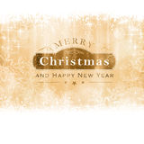Cartolina d'auguri dorata di Buon Natale Fotografie Stock Libere da Diritti