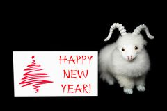 Cartolina d'auguri o cartolina del nuovo anno con la capra Immagine Stock