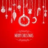Cartolina d'auguri rossa di Natale con la bagattella d'attaccatura Immagine Stock Libera da Diritti