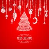Cartolina d'auguri rossa di Natale con la bagattella d'attaccatura Fotografia Stock Libera da Diritti