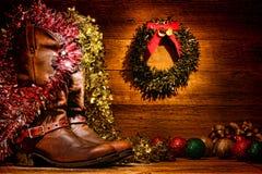 Cartolina di Natale ad ovest americana degli stivali di cowboy del rodeo Immagini Stock Libere da Diritti