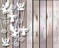 Cartolina di Natale allegra con gli angeli ed i giocattoli Fotografia Stock Libera da Diritti