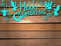 Cartolina di Natale allegra con gli angeli ed i giocattoli Fotografia Stock