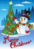Cartolina di Natale allegra con il pupazzo di neve 1 Fotografie Stock