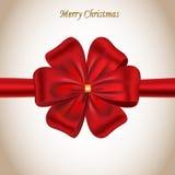 Cartolina di Natale allegra con un arco rosso Fotografie Stock Libere da Diritti