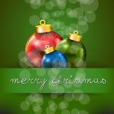 Cartolina di Natale allegra verde con natale colorato tre Fotografie Stock