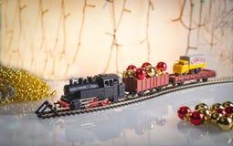 Cartolina di Natale Biscotti Assorted del pan di zenzero di natale Villaggio del pan di zenzero di Natale, casa, treno, albero `  Fotografia Stock Libera da Diritti