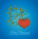 Cartolina di Natale blu con il ramo del vischio Immagine Stock