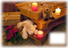 Cartolina di Natale con gli orsi e le candele Immagini Stock
