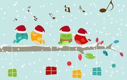 Cartolina di Natale con gli uccelli ed il contenitore di regalo Immagini Stock