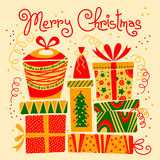 Cartolina di Natale con i contenitori di regalo Fotografia Stock Libera da Diritti