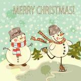 Cartolina di Natale con i pupazzi di neve nello stile d'annata Fotografie Stock Libere da Diritti