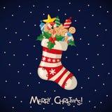 Cartolina di Natale con il calzino pieno dei regali Fotografie Stock Libere da Diritti