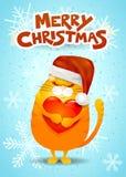 Cartolina di Natale con il gatto, il cappello di Santa ed il testo Fotografia Stock Libera da Diritti