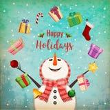 Cartolina di Natale con il pupazzo di neve di manipolazione Fotografie Stock Libere da Diritti