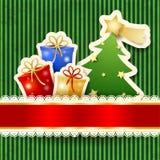Cartolina di Natale con l'albero ed i regali di carta Fotografia Stock