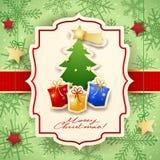 Cartolina di Natale con l'albero, i regali ed il testo Immagine Stock
