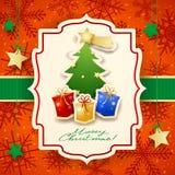 Cartolina di Natale con l'albero, i regali ed il testo Fotografie Stock