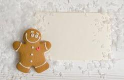 Cartolina di Natale con l'uomo di pan di zenzero Immagine Stock Libera da Diritti