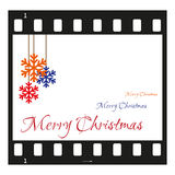 Cartolina di Natale con la striscia di pellicola Fotografie Stock
