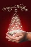Cartolina di Natale con le mani di un bambino nel rosso Immagini Stock Libere da Diritti