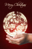 Cartolina di Natale con le mani di un bambino nel rosso Fotografia Stock