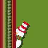 Cartolina di Natale con nascondersi del pupazzo di neve Fotografia Stock
