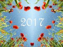 Cartolina di Natale con un cuore dei papaveri e neve e il inscript Fotografia Stock