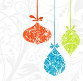 Cartolina di Natale con un ornamento,   fotografia stock