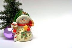 Cartolina di Natale con un pupazzo di neve Fotografie Stock Libere da Diritti