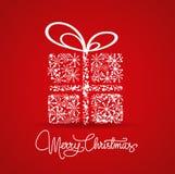 Cartolina di Natale con un regalo Immagini Stock