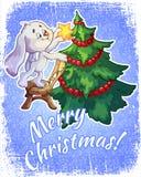 Cartolina di Natale con una lepre e un albero di Natale Immagini Stock