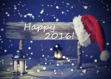 Cartolina di Natale d'annata con il segno, lume di candela, 2016 felice Fotografia Stock