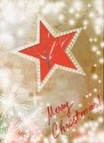 Cartolina di Natale d'annata con la stella rossa con i fiocchi di neve Immagine Stock