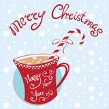Cartolina di Natale del nuovo anno con la tazza e la caramella Fotografie Stock