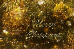 Cartolina di Natale elegante in verdi ed ori Fotografia Stock
