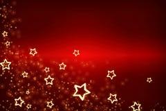 Cartolina di Natale Fondo rosso per la festa Stelle d'oro come struttura su un fondo rosso fotografia stock libera da diritti